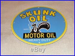 Vintage Skunk Heavy Duty Motor Oil Animal 11 3/4 Porcelain Metal Gasoline Sign